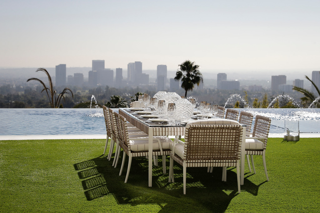 . This Thursday, Jan. 26, 2017, photo shows an outdoor dining area next to an 85-foot infinity swimming pool overlooking Los Angeles at a $250 million mansion in the Bel-Air area of Los Angeles. At $250 million, the new mansion in the exclusive Bel-Air neighborhood of Los Angeles is the most expensive home listed in the U.S. (AP Photo/Jae C. Hong)