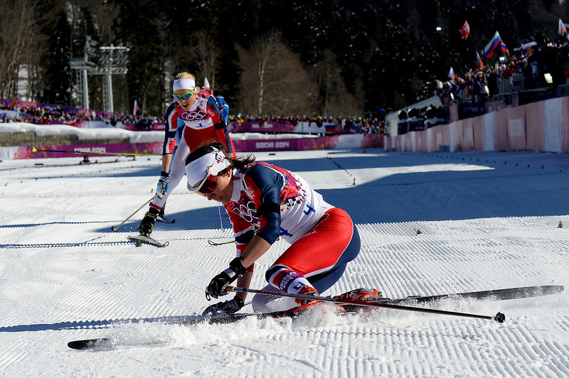 . Heidi Weng and Therese Johaug of Norway collapse in the snow after competing in the Ladies\' Skiathlon 7.5 km Classic + 7.5 km Free during day one of the Sochi 2014 Winter Olympics at Laura Cross-country Ski & Biathlon Center on February 8, 2014 in Sochi, Russia.  (Photo by Harry How/Getty Images)