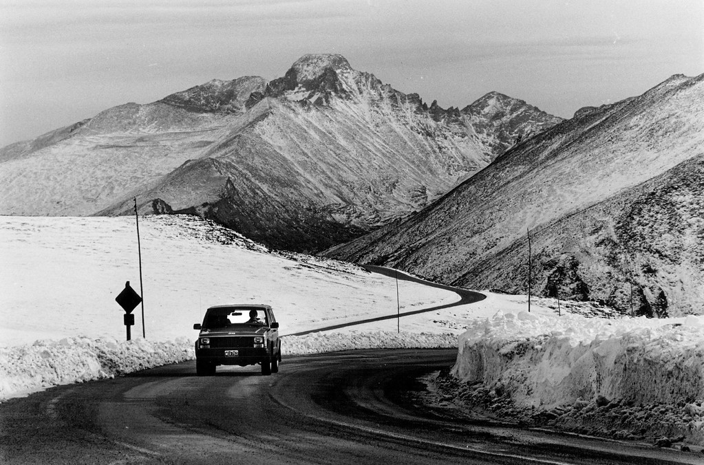 . A lone driver passes through a snowy area near the Lava Cliff on Trail Ridge Road in Rocky Mountain Park in 1987. (Karen Schulenburg/The Denver Post)