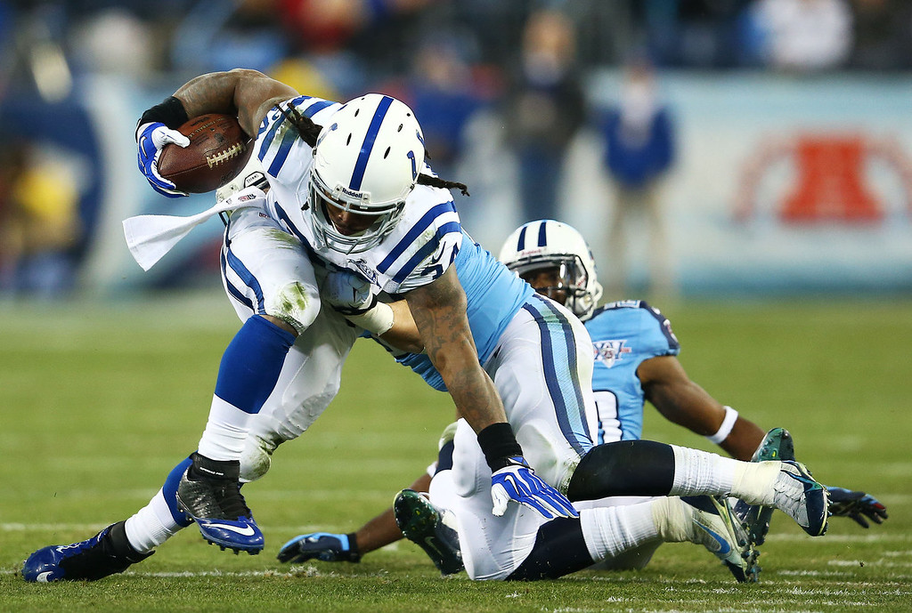 . Trent Richardson #34 of the Indianapolis Colts is tackle by  Colin McCarthy #52 of the Tennessee Titans in the second quarter at LP Field on November 14, 2013 in Nashville, Tennessee.  (Photo by Andy Lyons/Getty Images)