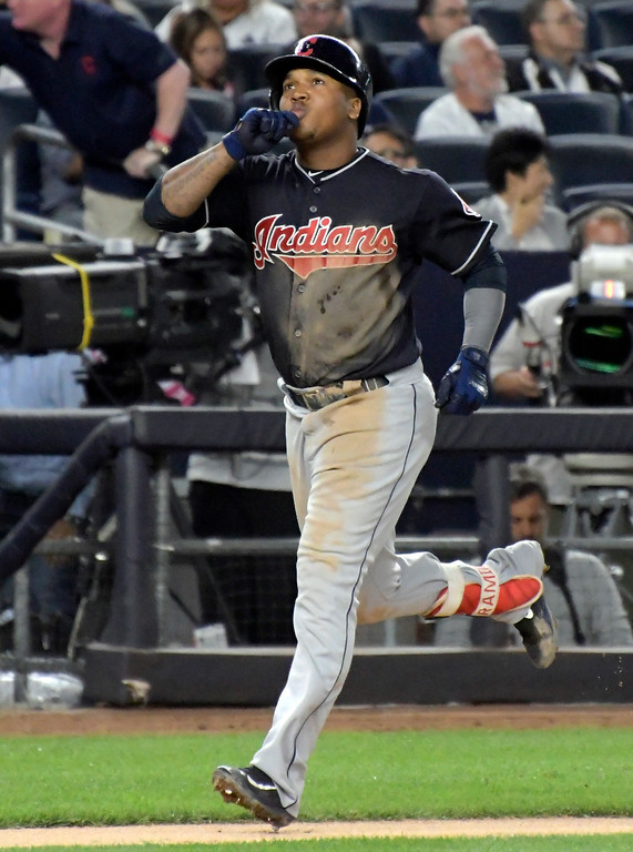 . Cleveland Indians\' Jose Ramirez reacts as he comes home after hitting a home run during the sixth inning of a baseball game against the New York Yankees on Monday, Aug. 28, 2017, at Yankee Stadium in New York. (AP Photo/Bill Kostroun)