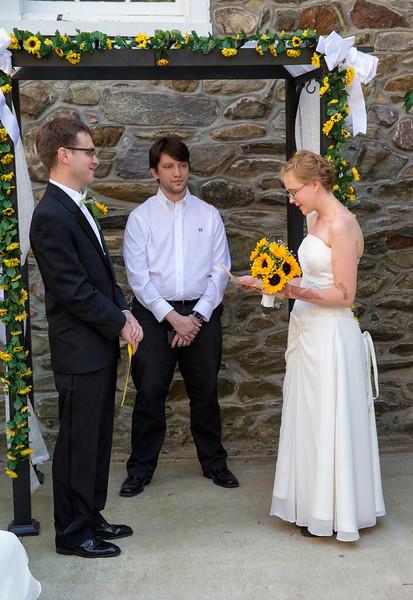 Bride reading vows wide shot.jpg