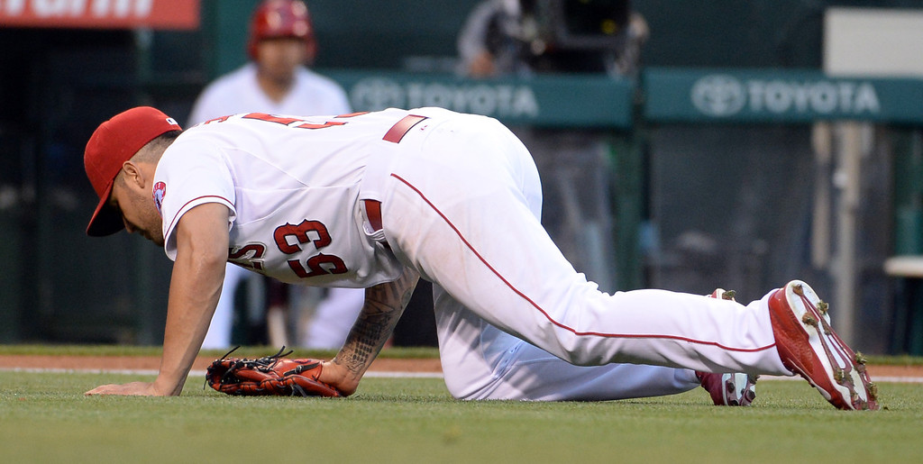 . Los Angeles Angels starting pitcher Hector Santiago (53) goes down injured after committing a throwing error on a ground ball by New York Yankees\' Brett Gardner (not pictured) in the first inning of a baseball game at Anaheim Stadium in Anaheim, Calif., on Wednesday, May 7, 2014.  (Keith Birmingham Pasadena Star-News)