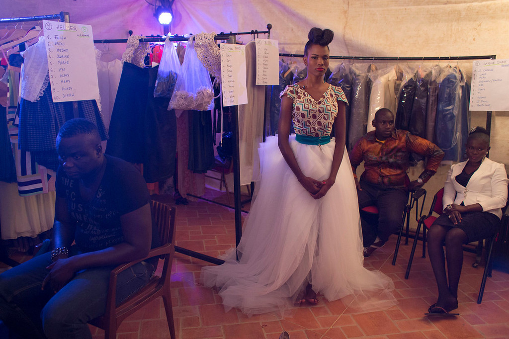 . A model wearing a creation by Elie Kuame of Lebanon and Ivory Coast waits backstage at Hotel des Almadies, in Dakar, Senegal, Saturday, June 22, 2013. After a Friday show held in a dusty marketplace in the working class suburb of Guediawaye, the runway finale of Dakar Fashion Week was held at a luxury hotel and showcased the work of 14 designers from West Africa, Europe, South America, and the Caribbean. (AP Photo/Rebecca Blackwell)