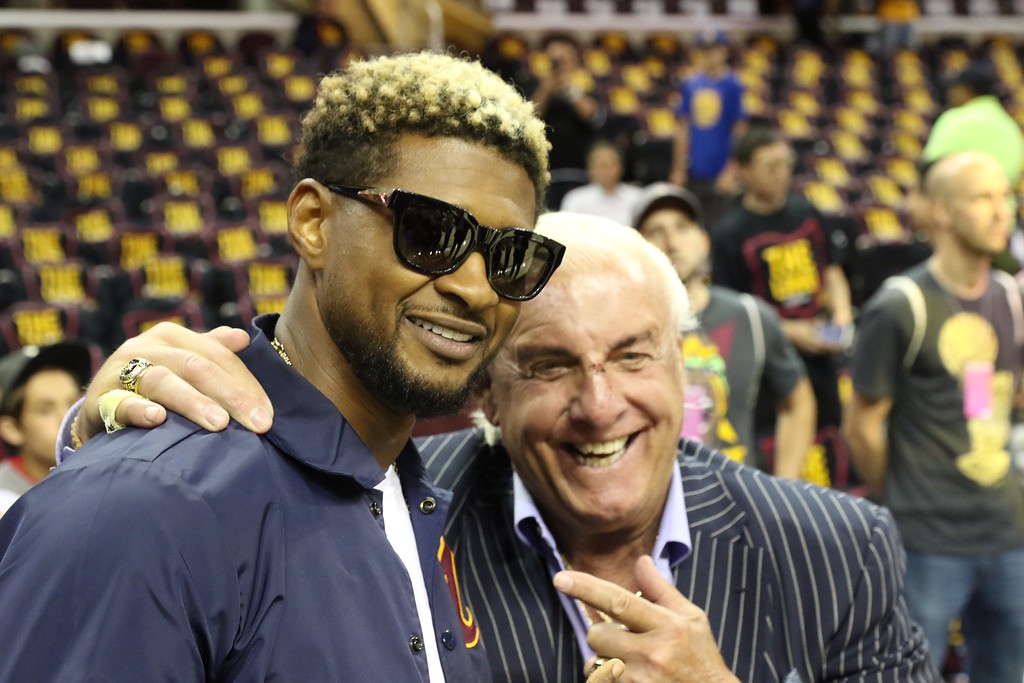 . Tim Phillis - The News-Herald Usher and Ric Flair before Game 3 of the NBA Finals between the Cavaliers and Warriors on June 7 in Cleveland.