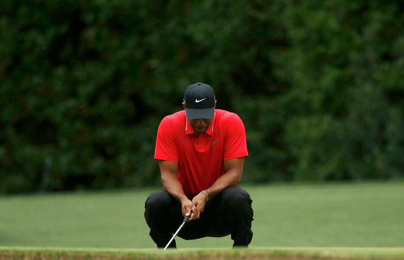 . Tiger Woods of the U.S. reacts to missing a birdie putt on the fourth green during final round play in the 2013 Masters golf tournament at the Augusta National Golf Club in Augusta, Georgia, April 14, 2013.   REUTERS/Phil Noble