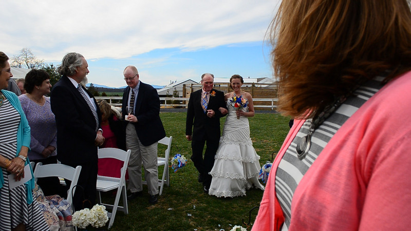 Melissa and her father walking down the isle.