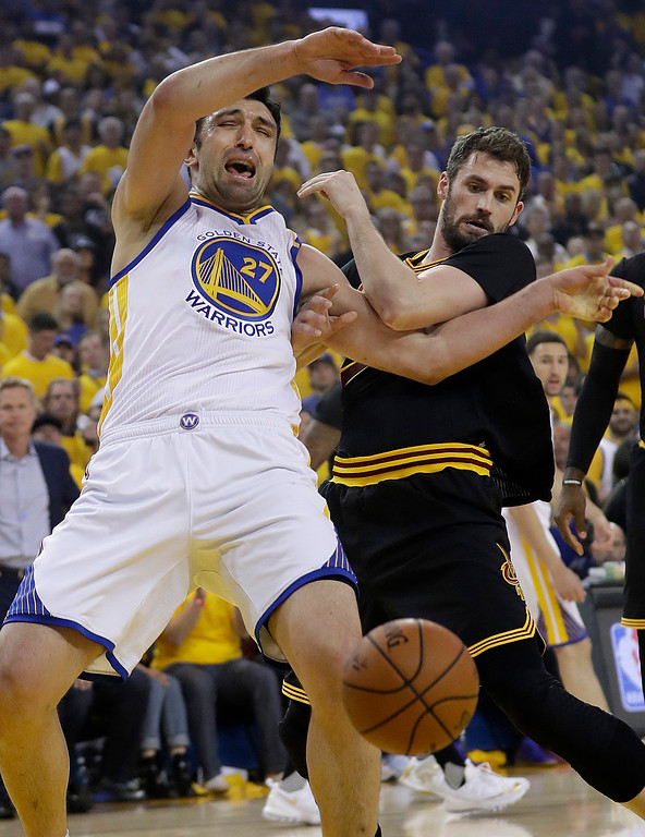 . Golden State Warriors center Zaza Pachulia (27) and Cleveland Cavaliers forward Kevin Love battle for a rebound during the first half of Game 5 of basketball\'s NBA Finals in Oakland, Calif., Monday, June 12, 2017. (AP Photo/Marcio Jose Sanchez)