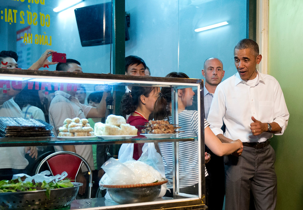 . President Barack Obama greets women at the door as he walks from the Bún chả Hương Liên restaurant after having dinner with American Chef Anthony Bourdain in Hanoi, Vietnam, Monday, May 23, 2016. (AP Photo/Carolyn Kaster)