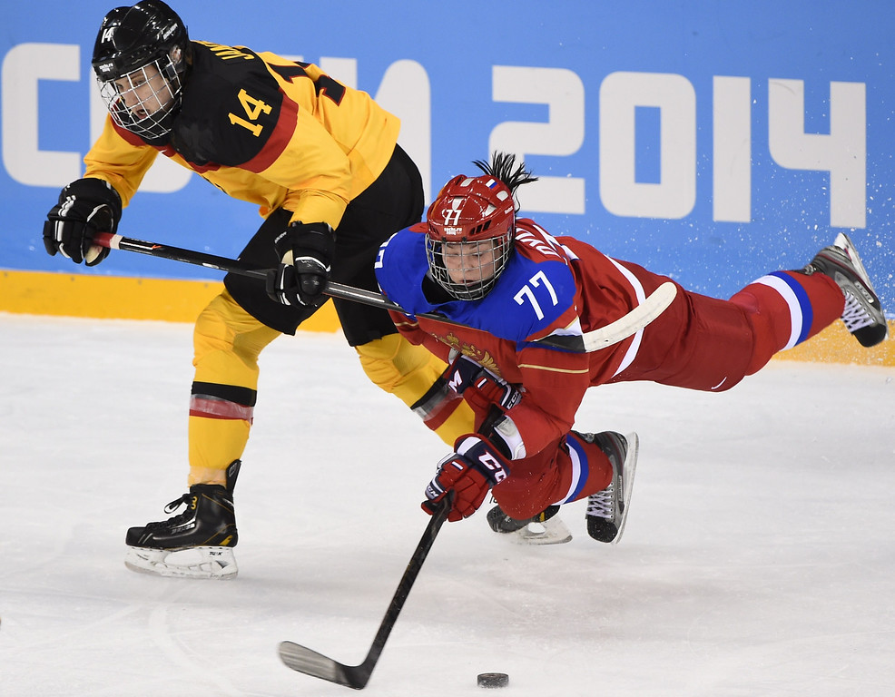 . Germany\'s Jacqueline Janzen (L) vies with Russia\'s Inna Dyubanok during the Women\'s Ice Hockey Group B match between Russia and Germany at the Shayba Arena during the Sochi Winter Olympics on February 9, 2014. JONATHAN NACKSTRAND/AFP/Getty Images