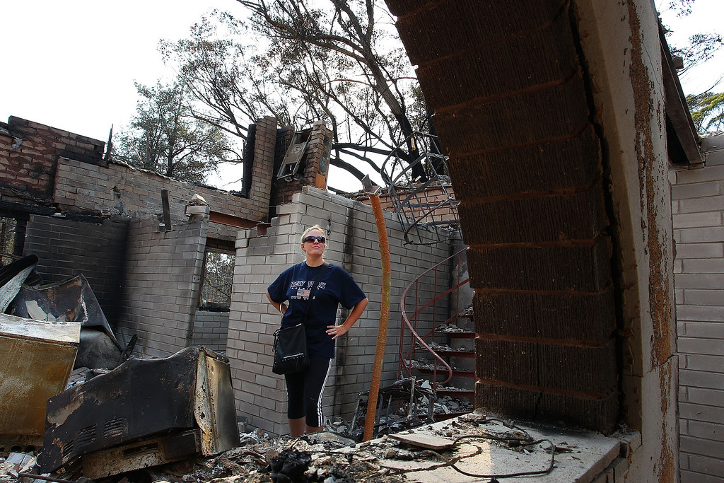 . Lyndal Rogers stands in her childhood home destroyed by fire on October 18, 2013 in Winmalee, Australia.   (Photo by Lisa Maree Williams/Getty Images)