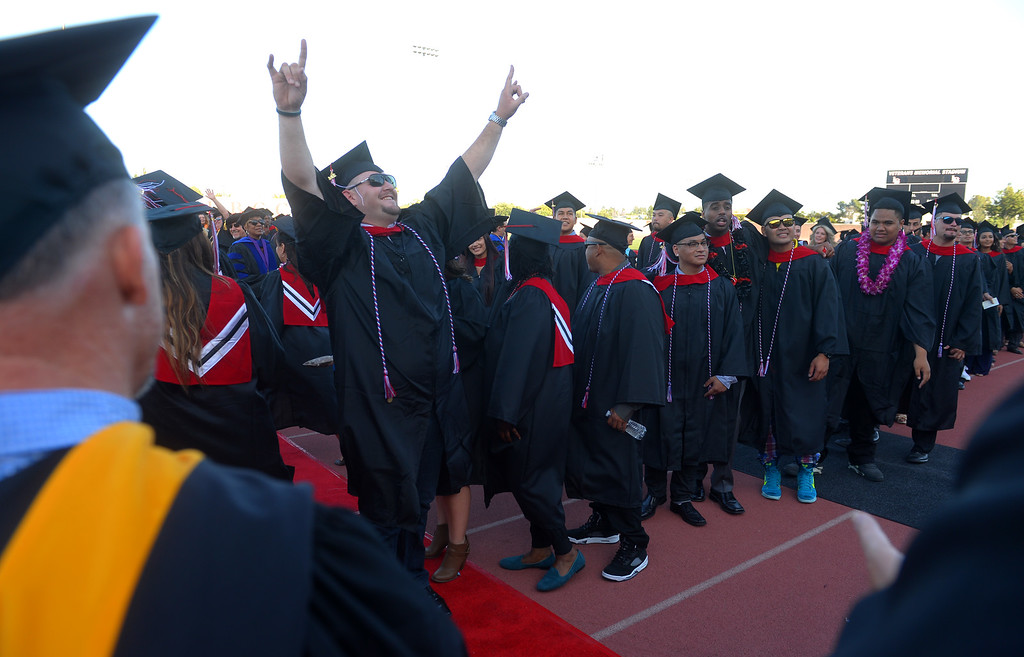 . Long Beach City College\'s class of 2014 march in to Veterans Memorial Stadium to receive their certificates and degrees in Long Beach, CA on Thursday, June 5, 2014. (Photo by Scott Varley, Daily Breeze)