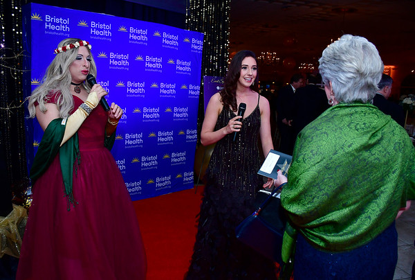11/16/2019 Mike Orazzi | Staff Tony DiPietro as Barbara Joan Street Stand, and Grace Gagnon interview guests during the Bristol Hospital Ball held at the Aqua Turf Club in Southington on Saturday night.