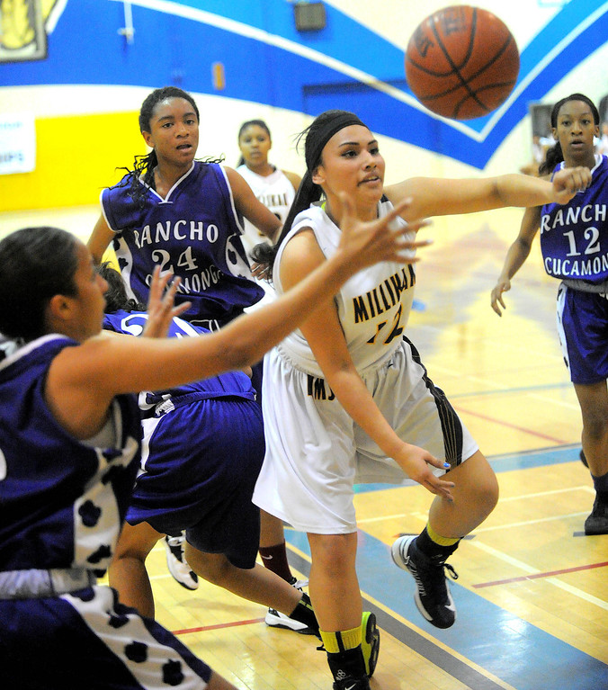 . 02-16-2012--(LANG Staff Photo by Sean Hiller)- Millikan vs. Rancho Cucamonga in Saturday night\'s  first-round CIF girls basketball game at Millikan High School in Long Beach. Angie Marroquin battles inside the key.