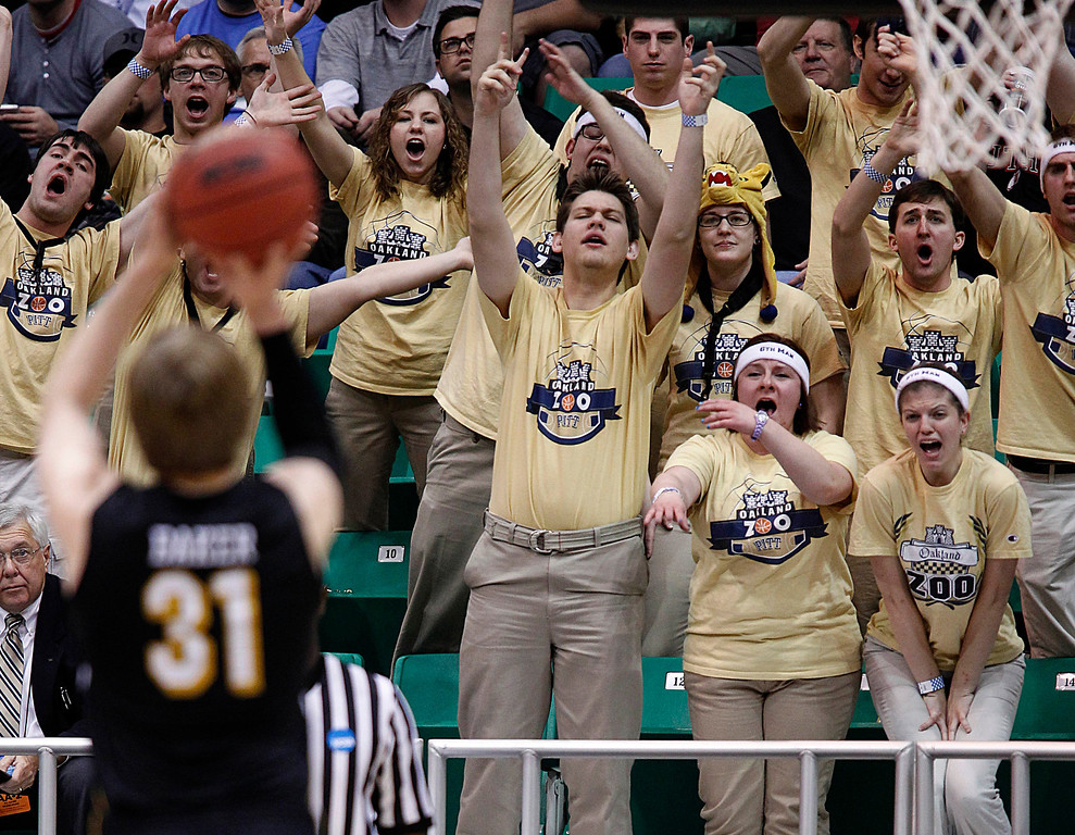 . Pittsburgh fans try to distract Wichita State\'s Ron Baker as he shoots a free throw during a second-round game in the NCAA college basketball tournament in Salt Lake City, Thursday, March 21, 2013. (AP Photo/George Frey)