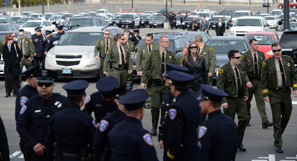 ". Members of law enforcement agencies from all over the state begin to arrive at the HP Pavilion in San Jose, Calif. on Thursday, March 7, 2013. Thousands are expected at the pavilion to mourn the loss of the two Santa Cruz police officers Loran ""Butch\"" Baker and Elizabeth Butler who lost their their lives in the line of duty on Feb. 26. (Dan Honda/Staff)"