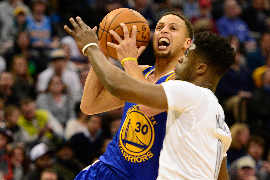 . DENVER, CO - JANUARY 13: Stephen Curry (30) of the Golden State Warriors goes up for a shot, but is defended by Emmanuel Mudiay (0) of the Denver Nuggets during the second half at the Pepsi Center on January 13, 2016 in Denver, Colorado. The Nuggets defeated the Warriors 112-110, giving the Warriors their third loss of the season. (Photo by Brent Lewis/The Denver Post)