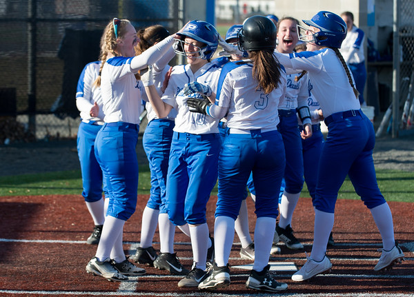 04/03/19 Wesley Bunnell | Staff Bristol Eastern softball defeated Plainville at Plainville High School on Wednesday afternoon. Annie Roux (10) is swamped by teammates after hitting a home run.