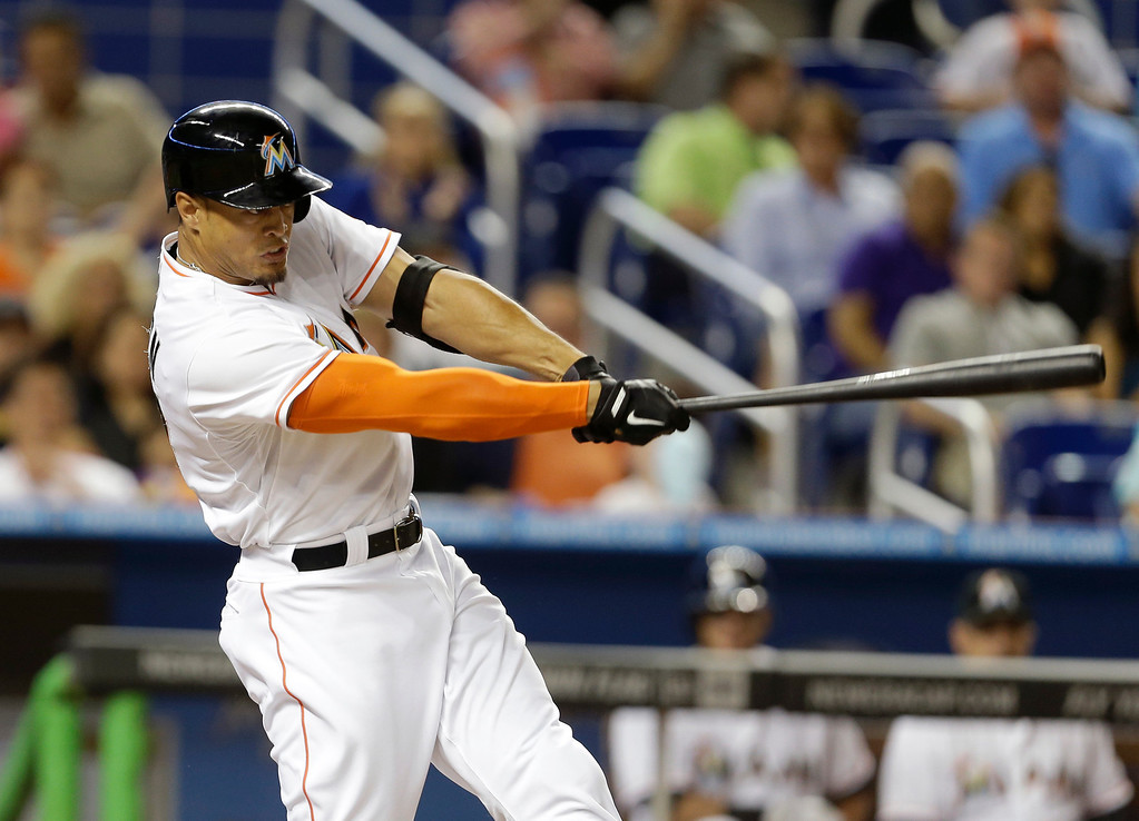 . Miami Marlins\' Giancarlo Stanton hits a two-run home run in the sixth inning of a baseball game against the Colorado Rockies, Wednesday, April 2, 2014, in Miami. The Rockies defeated the Marlins 6-5. (AP Photo/Lynne Sladky)