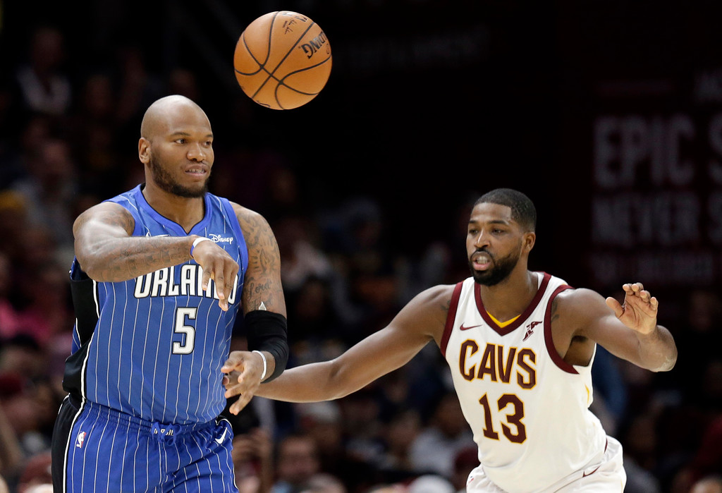 . Orlando Magic\'s Marreese Speights (5) passes over Cleveland Cavaliers\' Tristan Thompson (13) in the first half of an NBA basketball game, Saturday, Oct. 21, 2017, in Cleveland. (AP Photo/Tony Dejak)