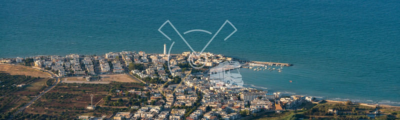 Aerial image of sunset over the coastal village of Torre Canne and Faro Di Torre Canne lighthouse