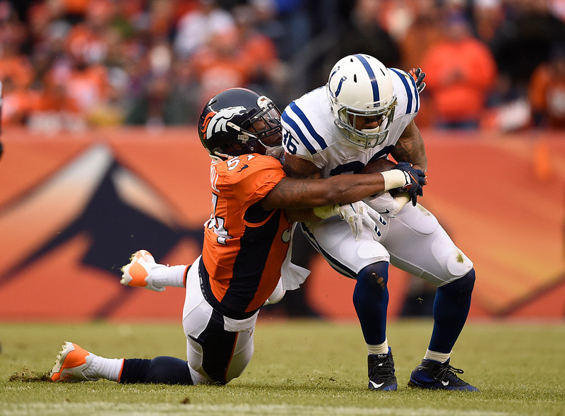 . Brandon Marshall (54) of the Denver Broncos tackles Dan Herron (36) of the Indianapolis Colts for a two yard loss in the first quarter. The Denver Broncos played the Indianapolis Colts in an AFC divisional playoff game at Sports Authority Field at Mile High in Denver on January 11, 2015. (Photo by AAron Ontiveroz/The Denver Post)