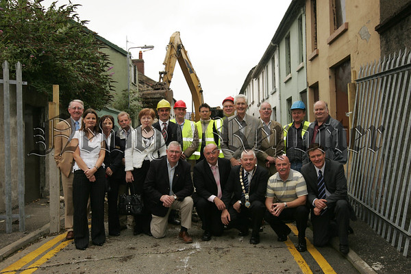 Pictured with Mayor Michael Cole are Councillors and employees of NIHE at the demolition of Sinclair Street on Tuedsay. Picture Peter Clarke. 07W33N34