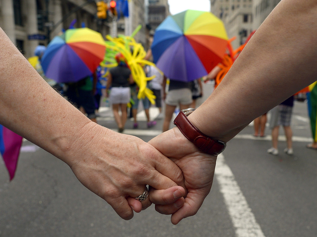 . Marchers walk down 5th Avenue during the 2013 New York Gay Pride March in New York on June 30, 2013. The 44th annual parade with more than 500,000 people is part of Gay Pride Week.    TIMOTHY CLARY/AFP/Getty Images