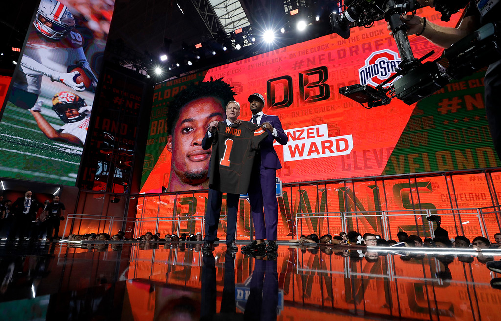 . Commissioner Roger Goodell, left, poses with Ohio State\'s Denzel Ward after he was selected by the Cleveland Browns during the first round of the NFL football draft, Thursday, April 26, 2018, in Arlington, Texas. (AP Photo/David J. Phillip)