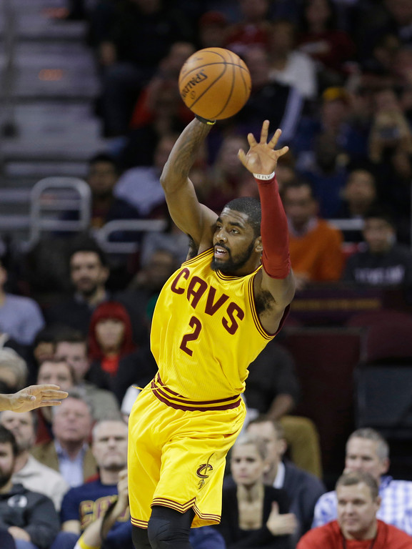 . Cleveland Cavaliers\' Kyrie Irving passes against the San Antonio Spurs during an NBA basketball game Wednesday, Nov. 19, 2014, in Cleveland. (AP Photo/Tony Dejak)