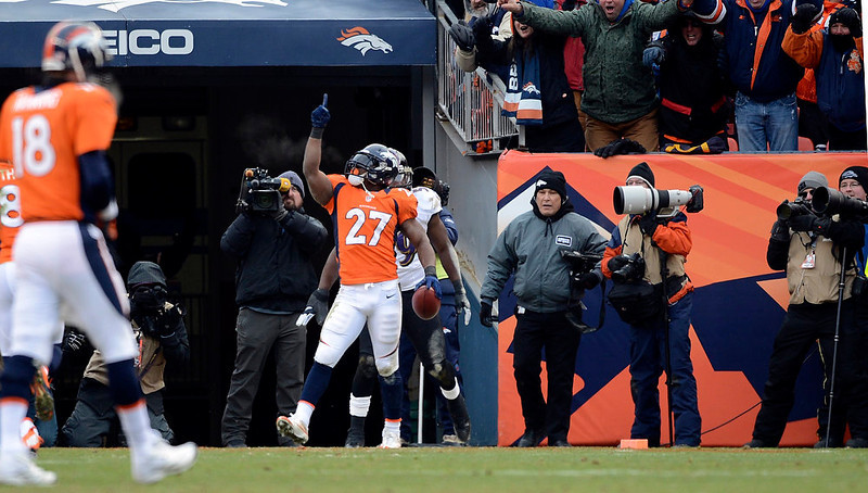 . Denver Broncos running back Knowshon Moreno (27) celebrates after scoring during the first half.  The Denver Broncos vs Baltimore Ravens AFC Divisional playoff game at Sports Authority Field Saturday January 12, 2013. (Photo by Hyoung Chang,/The Denver Post)