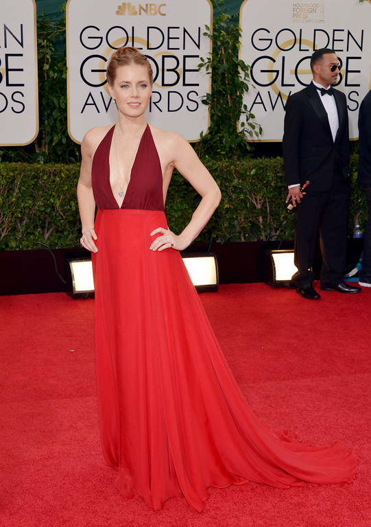 . Amy Adams arrives at the 71st annual Golden Globe Awards at the Beverly Hilton Hotel on Sunday, Jan. 12, 2014, in Beverly Hills, Calif. (Photo by John Shearer/Invision/AP)