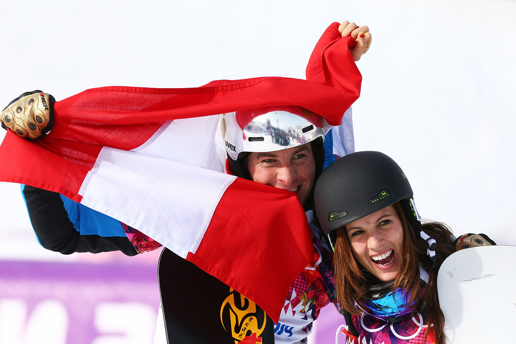 . SOCHI, RUSSIA - FEBRUARY 22:  Julia Dujmovits of Austria celebrates winning the gold medal with men\'s bronze medalist Benjamin Karl of Austria in the Snowboard Parallel Slalom on day 15 of the 2014 Winter Olympics at Rosa Khutor Extreme Park on February 22, 2014 in Sochi, Russia.  (Photo by Cameron Spencer/Getty Images)