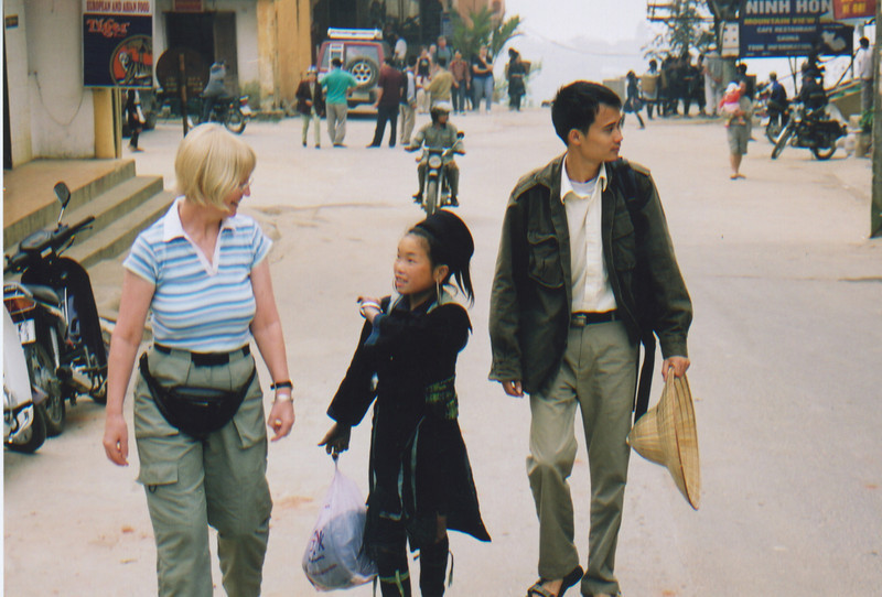 Wendy in Sapa, trying to resist Vu's sales technique while Tuan (our guide) looks away in despair