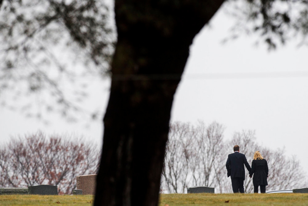. A couple holds hands as they walk away from the burial service of six-year-old Jack Pinto, one of 20 schoolchildren killed in the December 14 shootings at Sandy Hook Elementary School, at the Newtown Village Cemetery in Newtown, Connecticut, December 17, 2012. A gunman used a military-style assault rifle to kill six adults and 20 first-graders at the school before committing suicide last Friday. REUTERS/Lucas Jackson