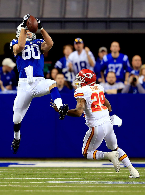 . INDIANAPOLIS, IN - JANUARY 04: Tight end Coby Fleener #80 of the Indianapolis Colts makes a catch as strong safety Eric Berry #29 of the Kansas City Chiefs defends during a Wild Card Playoff game at Lucas Oil Stadium on January 4, 2014 in Indianapolis, Indiana.  (Photo by Rob Carr/Getty Images)