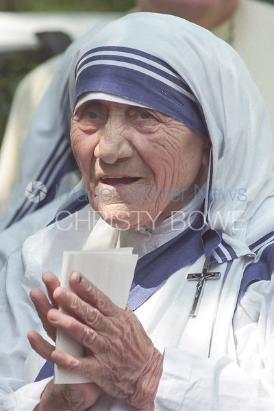 Mother Teresa pauses before going into church to  witness the novices of the Missionaries of Charity take their final vows.