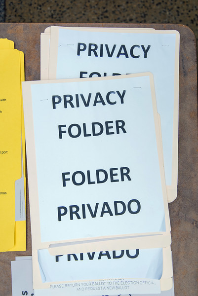 08/14/18  Wesley Bunnell | Staff  Privacy folders which will be handed to voters with their official ballot inside sit on a table at voting district 5-1 at the School Apartments on Bassett St on Tuesday afternoon.