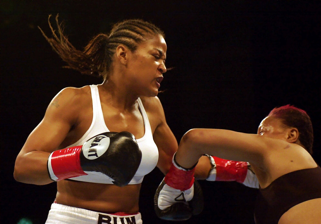 . Laila Ali, left, lands a left hook to knock her opponent, Marjorie Jones, to the canvas during the first round of their bout at the Unversal Amphitheatre in Universal City, Calif., Thursday, June 15, 2000. Ali knocked Jones out 68 seconds into the bout.  (AP Photo/Michael Caulfield)