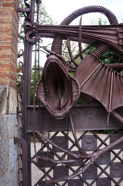 The dragon gate along the perimeter of the Finca Guell estate outside the city of Barcelona designed by Antonio Gaudi.