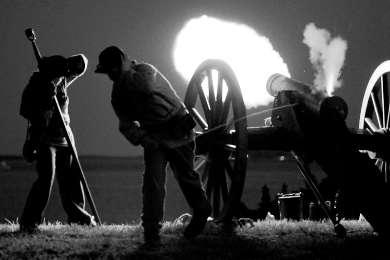 Bright flames shoot out of a 20-pound Parrott Riffle during a nighttime artillery demonstration at Patriots Point in Mt. Pleasant, South Carolina on Tuesday, April 12, 2011. ..The 150th Anniversary of the Firing on Ft. Sumter was commemorated with lectures, performances, demonstrations, and a living history throughout the area on James Island, Charleston, Mt. Pleasant, and Sullivan's Island during the week from April 8-14, 2011. Photo Copyright 2011 Jason Barnette