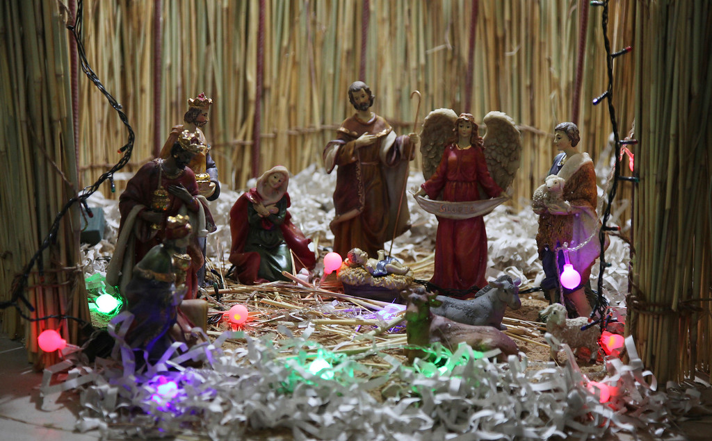 . This photo taken Saturday, Dec. 24, 2016, shows a nativity scene during a mass to celebrate Christmas at Philippe Amore Catholic Church in Goa, Mali. Just four years ago strict Islamic law was in force in this town, but Christians have returned to rebuild their congregation that fled the jihadist occupation. (AP Photo/Baba Ahmed)