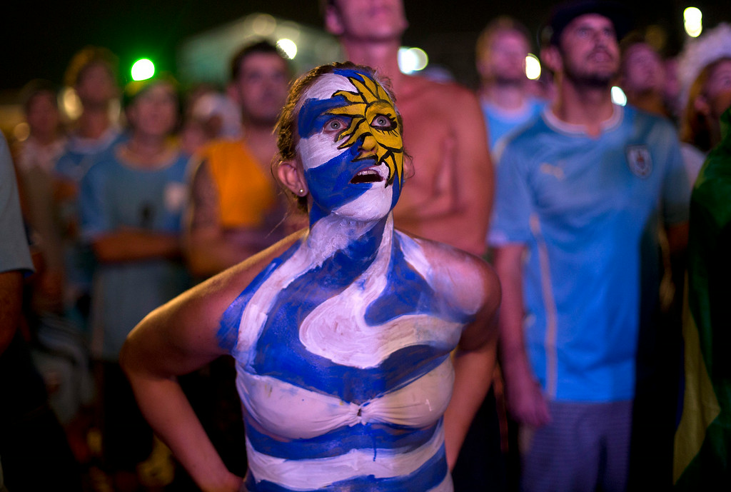 . Uruguay soccer fans watch their team\'s World Cup round of 16 match against Colombia on a live telecast inside the FIFA Fan Fest area on Copacabana beach in Rio de Janeiro, Brazil, Saturday, June 28, 2014. Uruguay lost to Colombia  2-0. (AP Photo/Silvia Izquierdo)