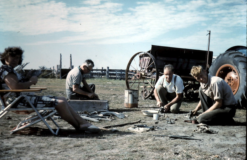 1962-5 (17) Doris & Alex Astfallck, Uncle Harry & Graham cleaning drill.JPG