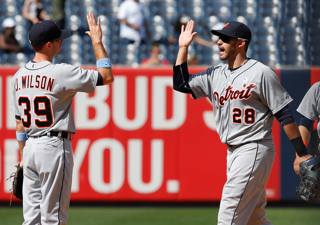 . Detroit Tigers shortstop Josh Wilson (39)  celebrates with Detroit Tigers right fielder J.D. Martinez (28) after the Tigers 12-4 victory over the New York Yankees in a baseball game at Yankee Stadium in New York, Sunday, June 21, 2015.  Martinez was responsible for six of the Tigers\' 12 runs with a three-run homer, a two-run home run, and a solo home run. (AP Photo/Kathy Willens)