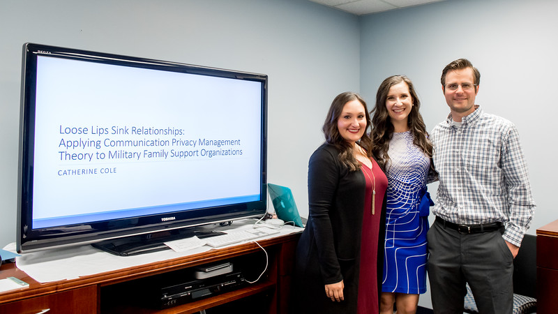 Student Catherine Cole (middle) takes a photo with her committee of thesis defense Dr. Michelle Maresh-Fuehrer (left) and Dr. Michael Sollitto.