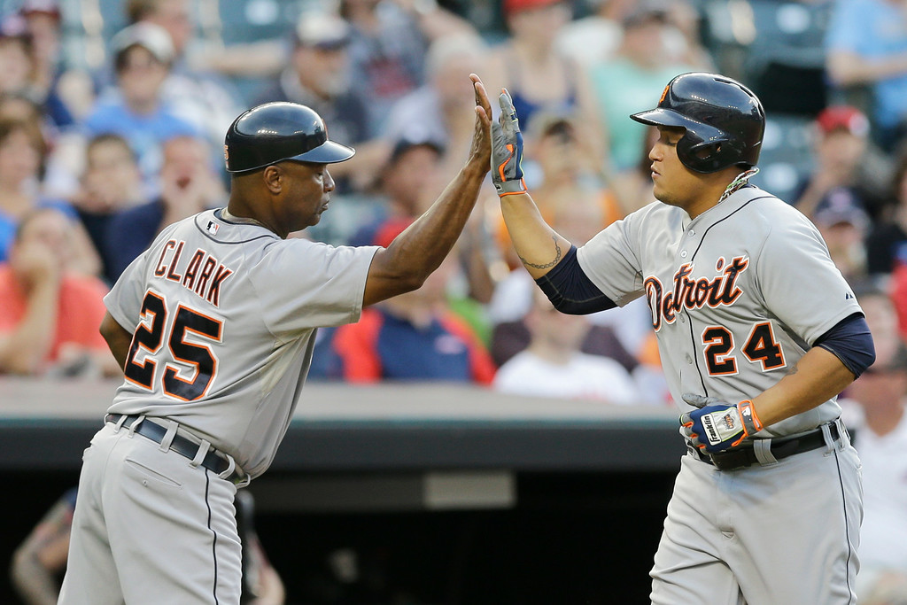 . Detroit Tigers third base coach Dave Clark, left, congratulates Detroit Tigers\' Miguel Cabrera after Cabrera hit a solo home run off Cleveland Indians relief pitcher Bryan Price in the eighth inning of a baseball game, Monday, Sept. 1, 2014, in Cleveland. (AP Photo/Tony Dejak)