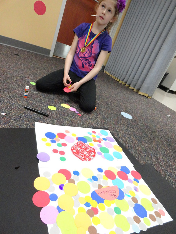 . Leah looks over her finished artwork during the Studio MPL Jr meeting at Mentor Public Library. (Courtesy Mentor Public Library)