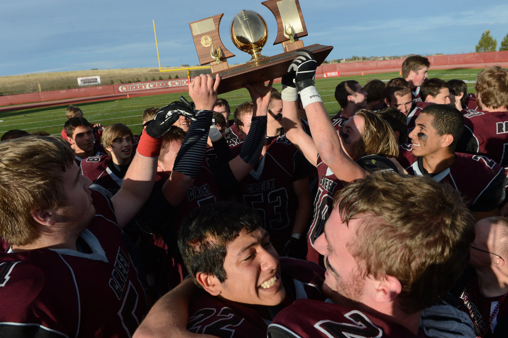. Silver Creek celebrates their victory in the Class 3A Championship football game, Saturday December 01, 2012.  The Silver Creek Raptors beat  the Rifle Bears 32 - 15 at Legacy Stadium in Aurora, CO. Craig F. Walker, The Denver Post
