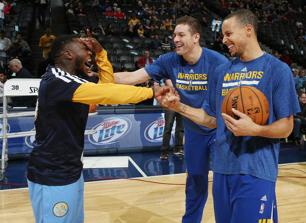 . Denver Nuggets guard Nate Robinson, left, jokes with Golden State Warriors forward David Lee, back right, and guard Stephen Curry before an NBA basketball game in Denver, Monday, Dec. 23, 2013. (AP Photo/David Zalubowski)